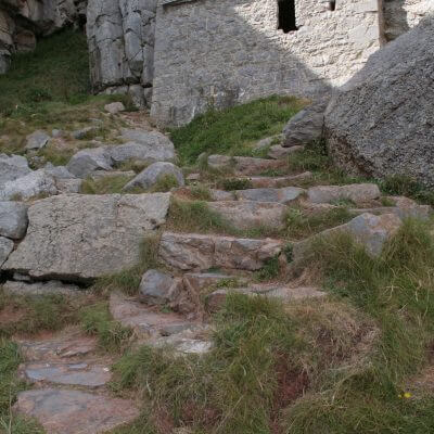 Hiking to St Govan's Chapel on a pilgrimage or mission trip to Wales with Wonder Voyage.